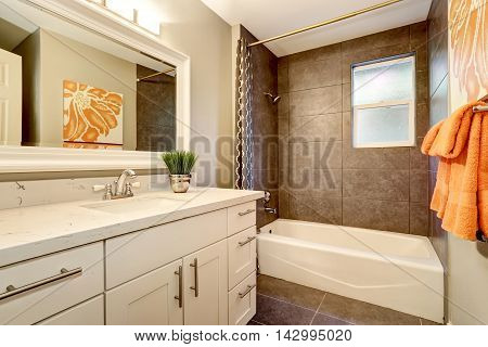 Bathroom Interior With White Vanity, Big Mirror And Tile Floor.