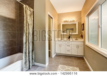 Bathroom Interior With Nice Vanity And Tile Trim.