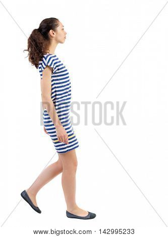 back view of walking  curly woman.  backside view of person.  Rear view people collection. Isolated over white background. Swarthy girl in a checkered dress goes on the side.