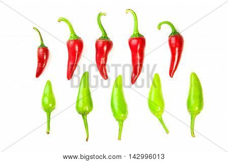 Many ripe red and green Chilli peppers on over white