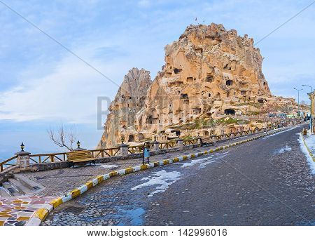 The ancient castle were carved in natural rock formation Uchisar Cappadocia Turkey.