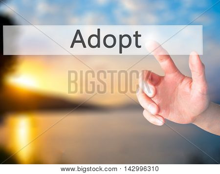 Adopt - Hand Pressing A Button On Blurred Background Concept On Visual Screen.