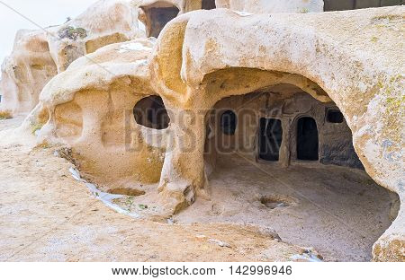 The ancient home was carved in rock and located in Uchisar rock-citadel Cappadocia Turkey.