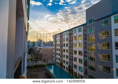 Condominium loft modern apartment living room sunset time colourful sky poster
