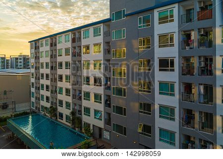 New Block Of Modern Condominium With Balconies And Blue Sky