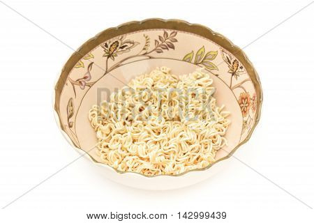 Noodles in painted bowl on isolated white background