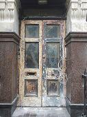 Old building door and entrance under refurbishment, London England poster