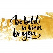 Be bold, be brave, be you. Inspiration saying calligraphy on golden dry brush stroke poster