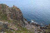 Pristine sea with rocky cliff at Dai Lanh cape point Mui Dien Phu Yen province easternmost of Viet nam poster