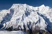 View of north face of Annapurna II and Annapurna IV from Kicho Tal (Ice Lake) on Round Annapurna trek Annapurna Circuit Manang Nepal. poster