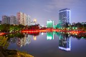 Nocturne view of the lake in the Yantan Park in Lanzhou (China) poster