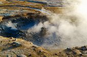 Boiling mud in the mudpot at Hverir geothermal area in north Iceland poster