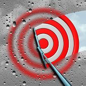 Concept of target as a blurry wet bulls eye dart target board being cleaned by a wiper as a business metaphor for clear focus or focused aim icon as a 3D illustration. poster