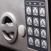 Electronic home safe keypad Small home or hotel wall safe with keypad closeup poster