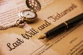 Vintage / retro style with a long shadow : Fountain pen a pocket watch on a last will and testament. A form is printed on a mulberry paper and waiting to be filled and signed by testator / testatrix. poster