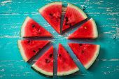 Watermelon slice popsicles on a blue rustic wood background Popular summer fruit with yummy watermelon Flat lay photography of Watermelon slice popsicles poster