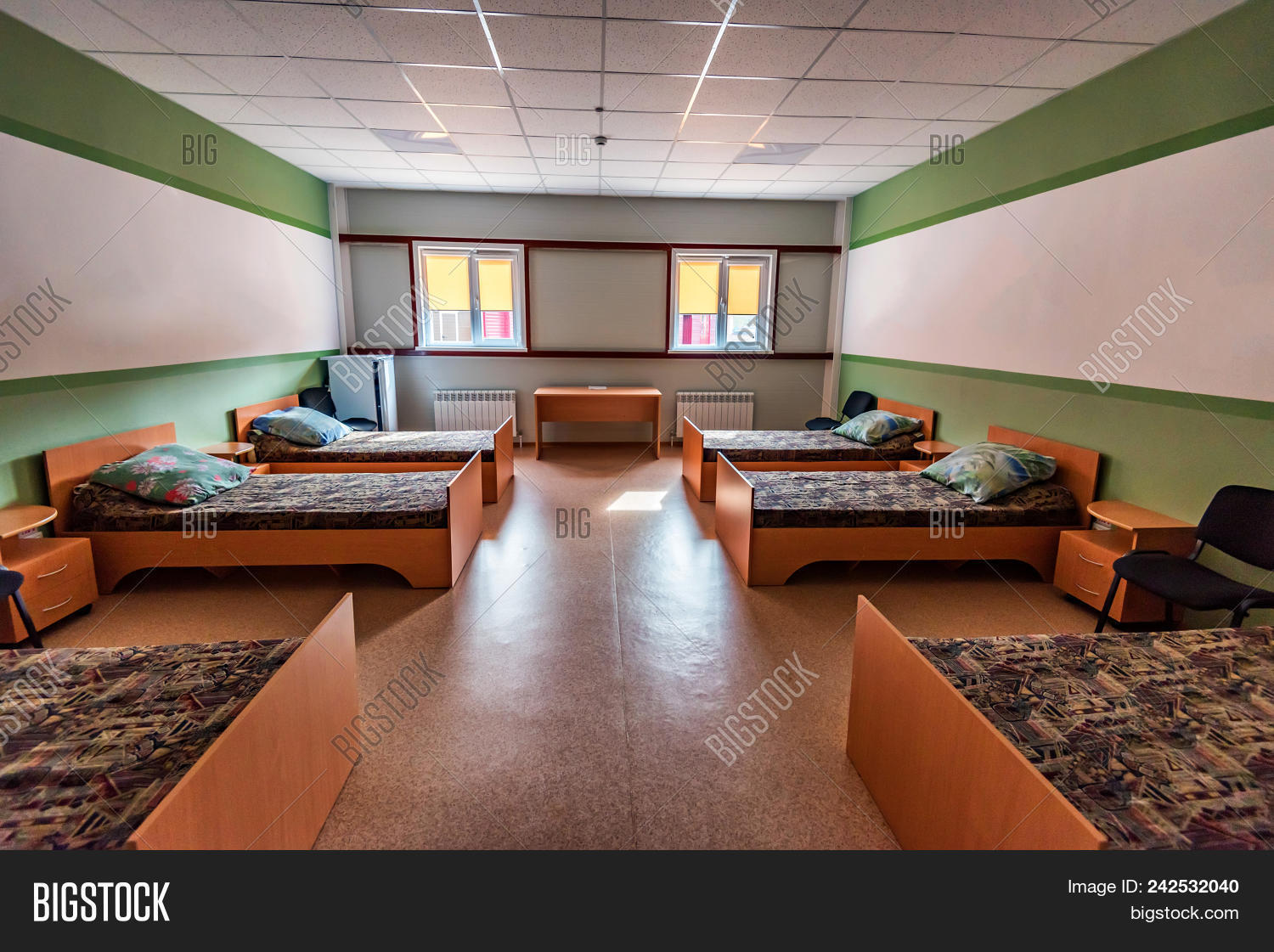 Interior Of Modern Hostel Room With Six Beds Travel Concept