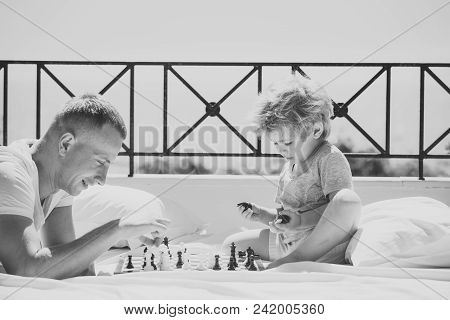 Kids Playing With Toys. Smart Toddler Concept. Parent Play Chess With Kid On Terrace On Sunny Day. D