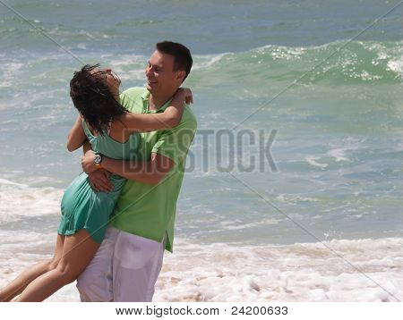 Young man and woman walking on the shore