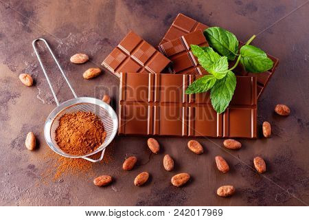 chocolate and cocoa with mint on dark background - sweet food