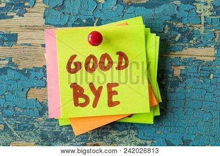 Good Bye  Text Written On Sticky Note On Rustic Wooden Background. Motivational Quotes