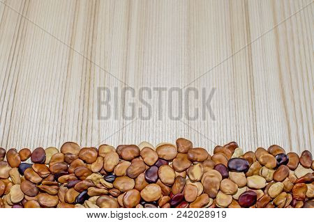The Fruits Of The Beans Lie On A Light Background Of A Wooden Table Of Ash With A Pronounced Texture