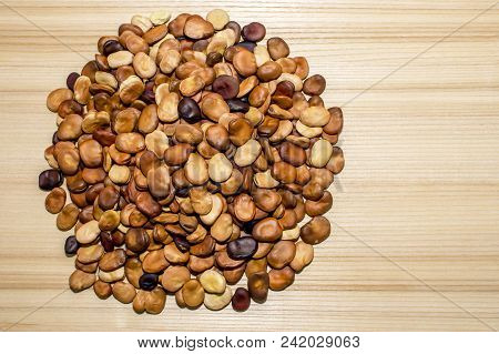 The Fruits Of The Beans Are Laid Out In A Circle Shape On A Light Background Of A Wooden Table Of As