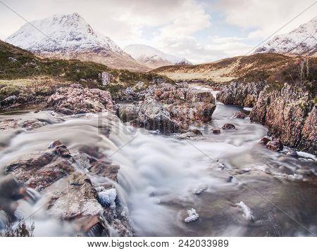 Spring River In Scottish Highlands.  Dramatic Landscape Of Glen Coe During Early Spring, Scotland