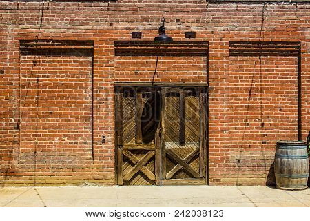 Old Wooden Double Doors Leading To Wine Storage Building
