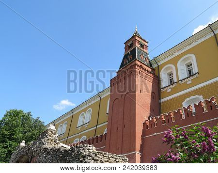 Moscow Kremlin in summer. View of the Kremlin wall, the Arsenal tower and the Italian grotto from the Alexander garden poster