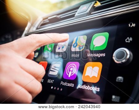 Palma De Mallorca, Spain - May 10, 2018: Woman Pressing Apple Maps Button On The Apple Carplay Main