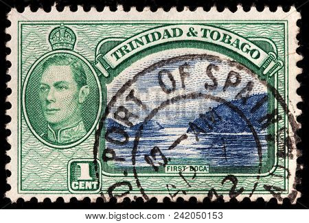 Luga. Russia - February 8, 2018: A Stamp Printed By Trinidad And Tobago Shows Image Portrait Of King