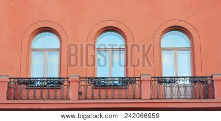 Balcony Of Old Historic Building With Simple Classic Arch Windows Close Up View. Facade Architecture