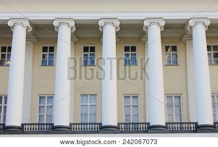 Ancient Historic Building Facade With Columns Exterior View. Old Greek Style Columns On Building Fro