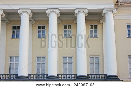 Historical Building Facade With Columns And Classic Windows. Old Ancient Greek Style Columns On Buil