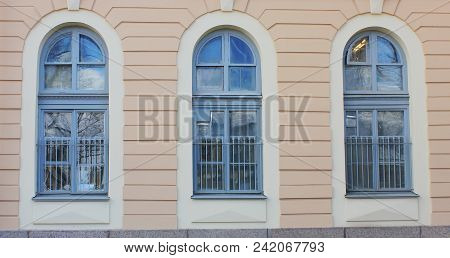 Three Arch Windows In Row On Building Wall Of Classic Stone House. Architecture Detail Of Historic P