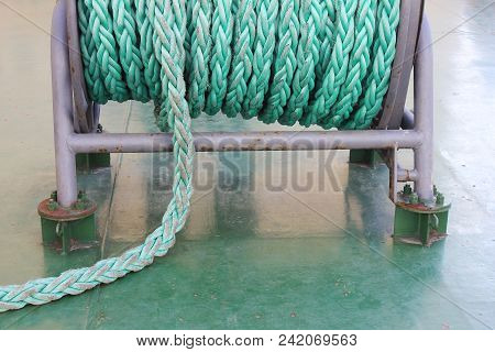 Reel With Used Old Ropes Sack At Naval Icebreaker Ship. Bright Green And Blue Cable Ropes Wire On La