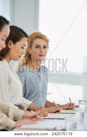 Beautiful Young Business Lady Attending Business Conference