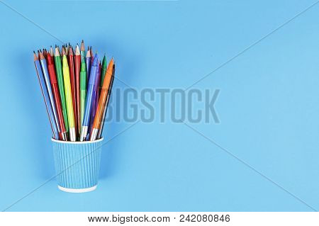 Minimalism. Metal Holder With Multicolored Pencils On Blue Background. Concept School, Still Life, C