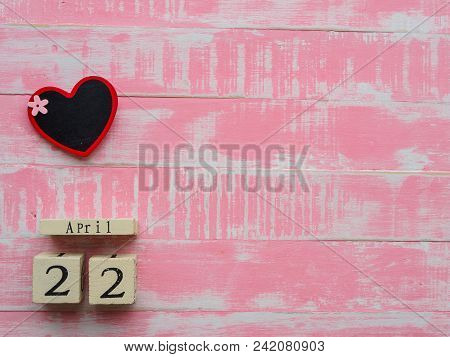 Wooden Block Calendar For World Earth Day April 22,wooden Block Calendar And Wooden Heart Board On B