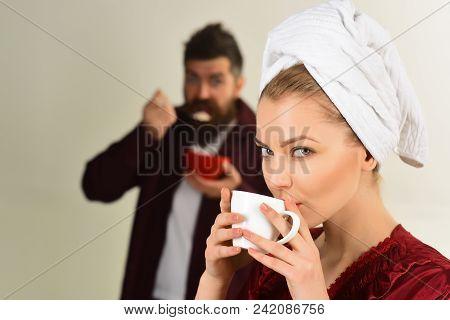 Couple. Loving Couple Having Breakfast. Romantic Couple Eating Breakfast - Cute Woman Enjoying Coffe