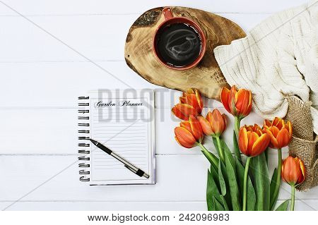 Overhead Shot A Garden Journal Notebook With Pen, Coffee And A Bouquet Of Orange And Yellow Tulips O