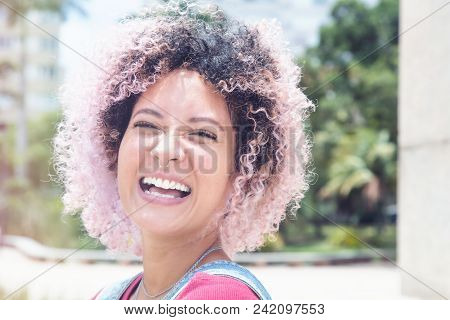 Portrait Of A Laughing Punk Girl With Pink Hair In Vintage Retro Look
