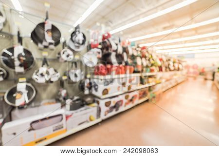 Blurred Customer Shopping For Kitchen, Dining Cookware Utensils