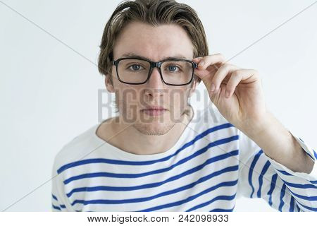 Surprised Young Man Staring At Camera Through Glasses. Surprising News Concept. Isolated Front View