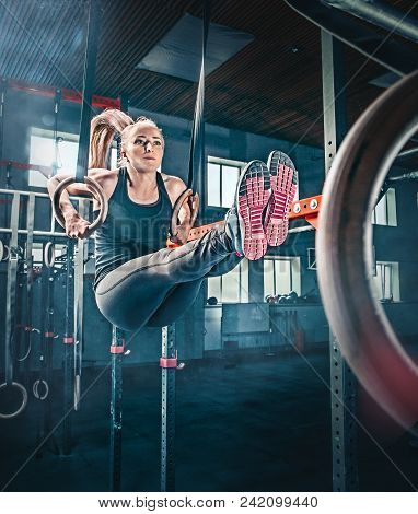 Concept: Power, Strength, Healthy Lifestyle, Sport. Powerful Attractive Muscular Woman Crossfit Trai