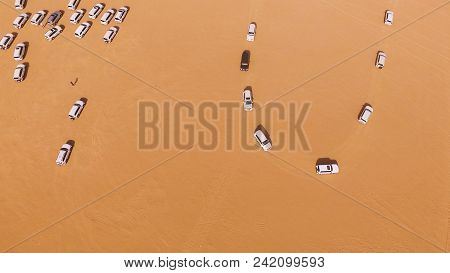 Suvs In The Desert. Stock. Driving On Jeeps On The Desert, Traditional Entertainment For Tourists In