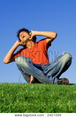Happy Teenager Singing And  Listening To Music
