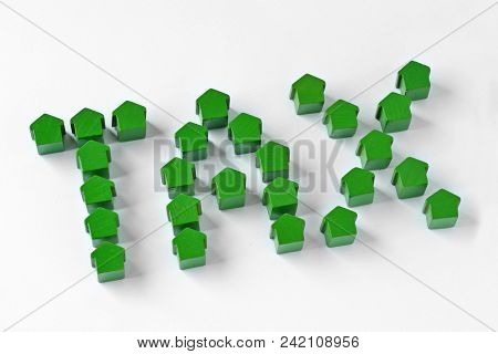 The Word Tax Written With Miniature Houses - Property Tax Concept