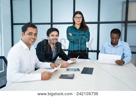 Confident Asian Female Business Leader Managing Strong Team. Serious Businesswoman With Crossed Arms